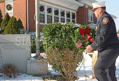 brl. fireman joe harriman presenting a wreath.