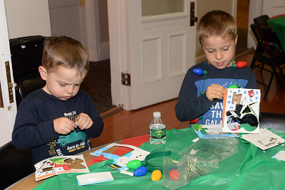 At the InfoAge Science History Center, Wall, New Jersey, Jackson and Gavin Adams enjoy some arts and crafts during Dinner with Santa held on 12/13, 2018. (STEVE WEXLER/THE COAST STAR).