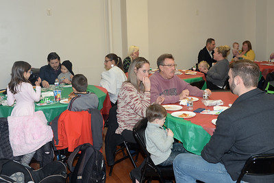 Dinner with Santa was held at InfoAge Science History Learning Center and Museum in Wall, New Jersey, where participants were treated to Pizza on 12/13/2018. (STEVE WEXLER/THE COAST STAR).