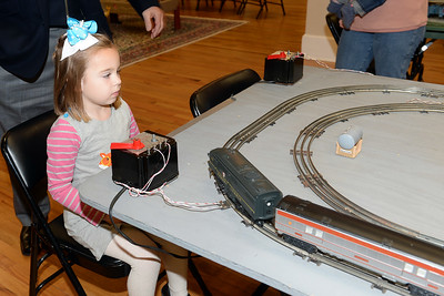 5 year old Kathryn Newberry of Wall, New Jersey gets to operate one of the several Holiday Train Layouts as part of Dinner with Santa held at InfoAge Science History Learning Center and Museum in Wall, New Jersey on 12/13/2018. (STEVE WEXLER/THE COAST STAR).