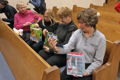 Crossing guards look over the gifts given to them by the kindergarten class of Spring Lake Heights Elementary School as Spring Lake Heights Police department honored their Crossing Guard Division with a breakfast  Wednesday December 19,2018. (MARK R. SULLIVAN /THE COAST STAR)