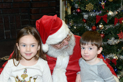 Madelyn and Jackson Squire of Wall, New Jersey visited with Santa Claus at the Dinner with Santa event held at the InfoAge Science Science History Learning Center and Museum in Wall, New Jersey on 12/13/2018. (STEVE WEXLER/THE COAST STAR).