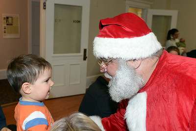 1 Year old Andrew Adams is greeted by Santa Claus at the InfoAge Science History Learning Center and Museum, Wall, New Jersey during Dinner with Santa held on 12/13/2018. (STEVE WEXLER/THE COAST STAR).