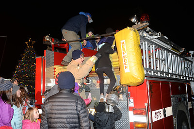The Spring Lake Heights Boro Fire Department gave residents a ride from Boro Hall to the fire house during the Tree Lighting Ceremony on 12/06/2018. (STEVE WEXLER/THE COAST STAR).