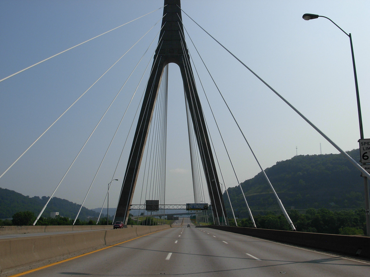 The Veterans' Memorial Bridge aka The Weirton-Steubenville Bridge, is located between Steubenville, OH and Weirton, WV.  It is a distinctive asymmetrical cable-stayed girder design and a truly monumental structure. <br /> <br /> The bridge is similar in appearance to the Ohio River crossing at East Huntington more than 200 miles to the south, utilizing the same design, only on a much larger scale. The cable‑stayed Veterans Memorial Bridge carrying US 22 between Weirton, West Virginia and Steubenville, Ohio is instead a monolith of both concrete and steel, combining the strengths of both and carrying not two but six lanes of traffic.  The cost of the bridge,completed in 1990, was $70 million.
