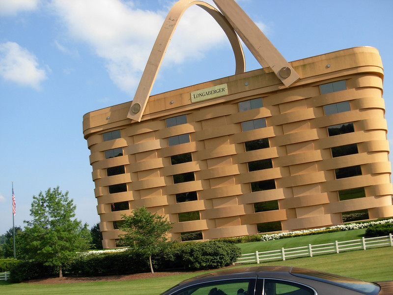 """The Longaberger Company Main Office in Newark,OH was a Hope-I-Don't-Wreck-My-Bike-Looking kinda of thing.  It really IS an office building.  Here's some info provided by Longaberger:<br /> <br /> Offices are situated around a seven-story, 30,000 sq. ft atrium where employees and guests can enjoy the natural daylight from the skylight. <br /> Two basket handles are attached to the building with replica copper and wooden rivets. <br /> The handles are heated to prevent ice from forming. <br /> Two Longaberger tags are attached to the sides of the building. The gold leaf painted tags are 725 lbs each and measure 25' long x 7' tall x 3"""" thick. <br /> A majority of the cherry woodwork in the building was harvested from Longaberger Golf Club® in Hanover, dried and milled in our facility, sawed and shaped at our Construction Woodshop, finished and installed by our Construction Division. <br /> <br /> <br /> Property size: 25 acres <br /> Building capacity: 500 employees <br /> Building footage: 180,000 square feet <br /> Total weight of building: Approximately 9,000 tons <br /> Total weight of handles: Approximately 150 tons <br /> Number of windows: 84 <br /> Seven stories in height <br /> 192' long x 126' wide at grade, widening to 208' long x 142' wide at roof <br /> 160 times longer, wider and taller than the Medium Market Basket"""