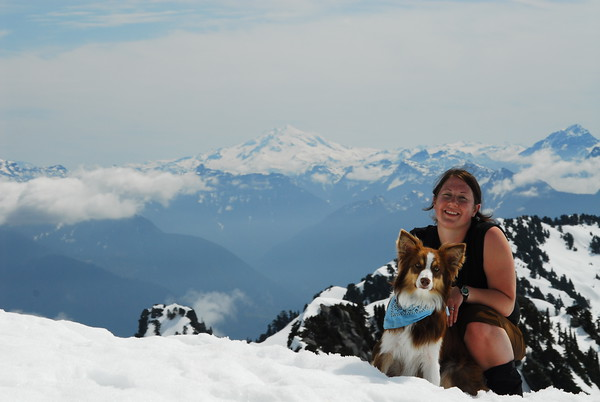 My wife and dog with Glacier Peak in the background.