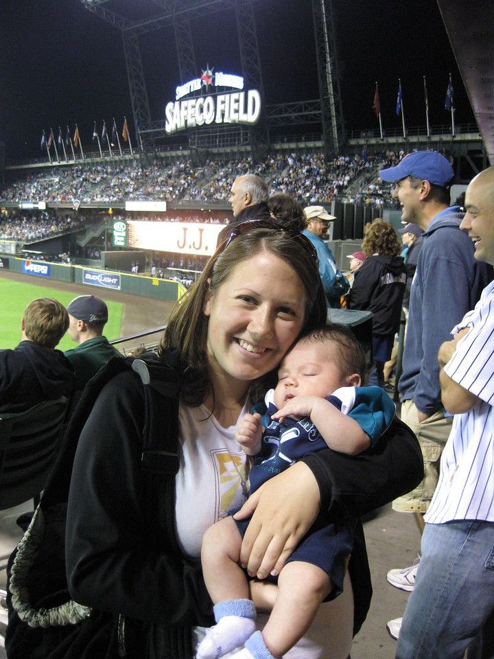 Safeco Field. His first of many games. He is a few months old.