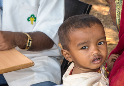 Another young patient being treated at an outdoor clinic by a TCF physician.