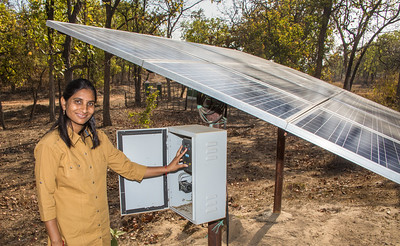 Ms. Kamlesh Singh Atri, wife of TCF Deputy Drector Sharad Kumar, showing a solar-powered water pump system installed by TCF in the core area of Bandhavgarh Park. The system provides drinking water to wildlife during the dry season, so animals are less likely to leave protected areas seeking water.