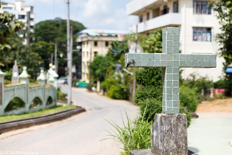 The Cross of Jesus in a courtyard area in Yangon, Myanmar.