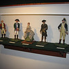 A display of figurines representing characters from the history of the house, including Major Andre, Robert Townsend and his sister Sally.