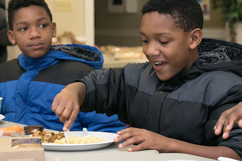 The Daily Bread has been serving up breakfast for the past 10 years at the Pilgrim Congregational Church in Leominster. Enjoying the breakfast is twins Brenden and Jaden Sayles, 10, from Fitchburg. SENTINEL & ENTERPRISE/JOHN LOVE