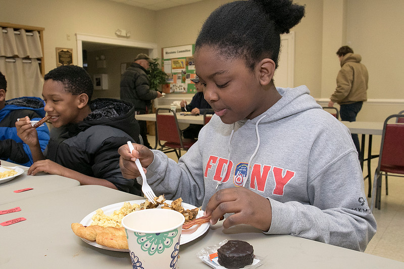 The Daily Bread has been serving up breakfast for the past 10 years at the Pilgrim Congregational Church in Leominster. Enjoying the breakfast is Jaida Sayles, 12, from Fitchburg. SENTINEL & ENTERPRISE/JOHN LOVE