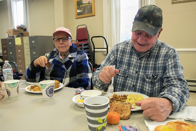 The Daily Bread has been serving up breakfast for the past 10 years at the Pilgrim Congregational Church in Leominster. Enjoying the breakfast is Ann Johnson and William Sampson who have been coming for about 2 years. SENTINEL & ENTERPRISE/JOHN LOVE
