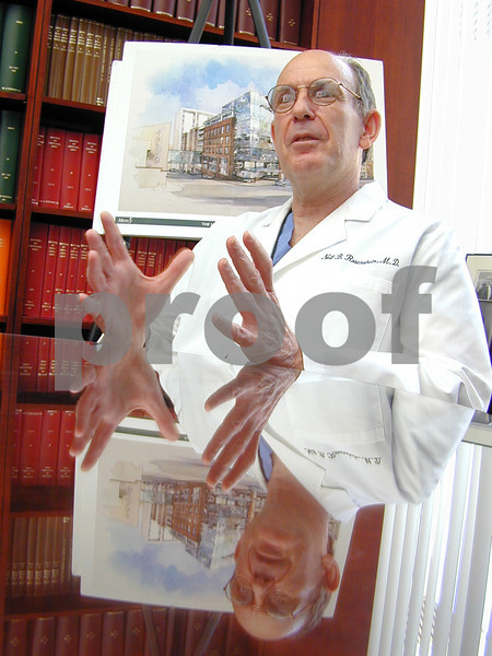 Neil B. Rosenshein, M.D.- director of The Gynecologic Oncology Center at Mercy Medical Center. Q and A shot in front of a rendering of the new building still under construction. MF-D 6/6/02.