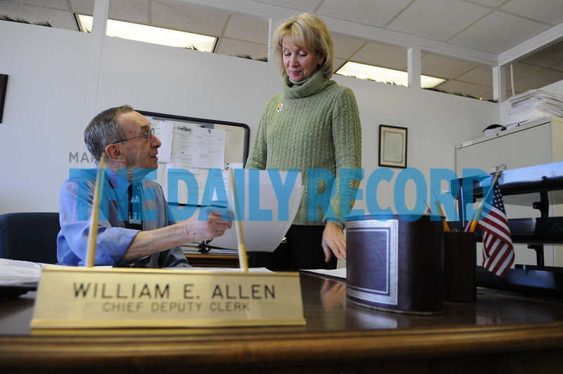 12.09.10 TOWSON, MD. L and R- William E. Allen, Chief Deputy Clerk for the Baltimore County Circuit Court and Sonia Reynolds, Manager Fiscal/non-Judicial shown here talking in Williams office. William has been working at the court for 56 years and is about to retire.  (Maximilian Franz/ The Daily Record)