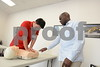 2.19.2016 BALTIMORE, MD- On Right, Colin Stewart, CPR Instructor, teaching Hyeonho Jeong in a Healthcare Provider CPR Class at The World Institute of Safety. (The Daily Record/Maximilian Franz).