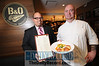 01.18.12- BALTIMORE, MD- L To R- B&O American Brasserie General Manager Marcus Garner holding a Menu and Executive Chef Thomas Dunklin, holding a plate of Seared Scallops and Chick-Pea Cakes on a Celery Root Puree with a side of Brussel Sprouts with a Lobster Bacon emulsion. (Maximilian Franz/The Daily Record)
