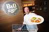 01.18.12- BALTIMORE, MD- B&O American Brasserie Executive Chef Thomas Dunklin, holding a plate of Seared Scallops and Chick-Pea Cakes on a Celery Root Puree with a side of Brussel Sprouts with a Lobster Bacon emulsion. (Maximilian Franz/The Daily Record)