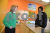 1.18.2016 BALTIMORE, MD- Mary Yaeger, franchise owner, and Will Brown, Customer from Laurel talking over the counter. Photo taken at Palm Beach Vapors in Odenton, MD. (The Daily Record/Maximilian Franz).