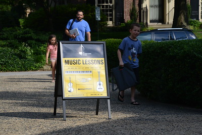 6-30-16 BALTIMORE, MD- Alex Maistros of Waverly, walking into The Baltimore School of Music with his 8 year old son Davis who is learning Piano and 6 year old duaghter Effie who is learing violin and Piano. Photos from The Baltimore School of Music, which teaches classical instruments and voice to students of all ages. (The Daily Record/Maximilian Franz)