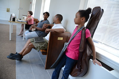 6-30-16 BALTIMORE, MD- Classical guitar student Leila waits for her class to begin. Photos from The Baltimore School of Music, which teaches classical instruments and voice to students of all ages. (The Daily Record/Maximilian Franz)