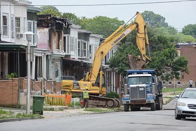 7-1-16 BALTIMORE, MD- Demolition of a home at on the 2700 block of Fenwick Avenue in the Coldstream Homestead Montebello neighborhood, which is surrounded by amenities like a golf course, lake and good schools, but it has still been one of the most blighted neighborhoods in Baltimore. Photos taken on a visit to the neighborhood for a story on demolition of vacant homes.  (The Daily Record/Maximilian Franz)