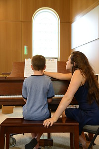 6-30-16 BALTIMORE, MD- Piano teacher Maria Scott working with 8 year old Davis Maistros. Photos from The Baltimore School of Music, which teaches classical instruments and voice to students of all ages. (The Daily Record/Maximilian Franz)