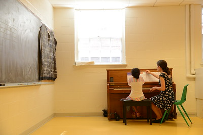 6-30-16 BALTIMORE, MD- Lena Seiger, teaching piano to 8 year old Alivia Gutierrez. Photos from The Baltimore School of Music, which teaches classical instruments and voice to students of all ages. (The Daily Record/Maximilian Franz)