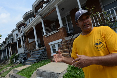 7-1-16 BALTIMORE, MD- Mark Washington, Executive Director of the Coldstream Homestead Montebello Community Corporation, seen here talking about the green space at the 2700 block of Tivoly Avenue, which was once lined with vacant row houses that were demolished in 2015. Photos taken on a visit to the neighborhood for a story on demolition of vacant homes.  (The Daily Record/Maximilian Franz)