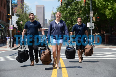 6.1.16 BALTIMORE, MD- From Left,  Eli Kamerow, Marketing Manager; Kelly Desmond, Operations Manager; and Andrew Nevin, Brand Ambassador at Galley foods, walking down the center of light street in Federal Hill holding food delivery bags that their drivers use to deliver orders. (The Daily Record/Maximilian Franz)
