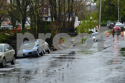 4.30.14  BALTIMORE, MD- Torrential rain fell on Baltimore, causing a lot of problems, including a street collapse that sent  dirt, cars and debris into the CSX tracks along 26th Street between Charles and St. Paul Streets. (The Daily Record/Maximilian Franz)