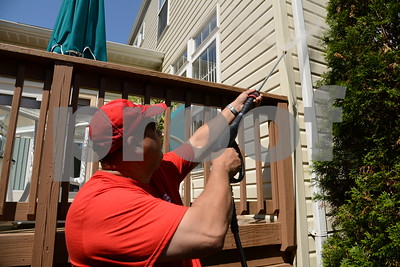 5.26.16 BALTIMORE, MD- Jim Brown, Franchise owner of Fish window cleaning, powerwashing a house near Annapolis. (The Daily Record/Maximilian Franz)