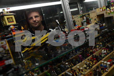 5.26.16 BALTIMORE, MD- Jason Barnes, owner of All Time Toys in historic Ellicott City, seen here arranging a display case filled with small toys and figurines. (The Daily Record/Maximilian Franz)