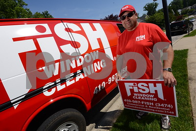 5.26.16 BALTIMORE, MD- Jim Brown, Franchise owner of Fish window cleaning, standing next to one of his work vans on a job site near Annapolis. (The Daily Record/Maximilian Franz)