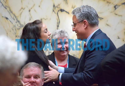Sen. Rich Madaleno, D-Montgomery County (right) hugs Del. Meagan Simonaire, R-Anne Arundel County (Left), after Simonaire voted in favor of a bill banning the practice of conversion therapy for LGBT youth. Simonaire said she voted against the bill so that no one would have to experience what she did after she was sent to conversion therapy. Her father, Sen. Bryan Simonaire, R-Anne Arundel County, voted against the bill in the Senate last week and advocated for the therapy if it was done in a loving way. Del. Bonnie Cullison, D-Montgomery County (center) and Madaleno are both openly gay members of the legislature.