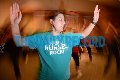 2.28.17 ANNAPOLIS, MD- Valerie Lehman, manager for palliative care and government affairs at Anne Arundel Medical Center,  working out in a Zumba class at AAMC.  (The Daily Record/ Maximilian Franz)