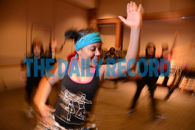 2.28.17 ANNAPOLIS, MD- Anne Arundel Medical Center employees working out in a Zumba class with Benin Davis, Zumba instructor with Evolution Fitness.  (The Daily Record/ Maximilian Franz)