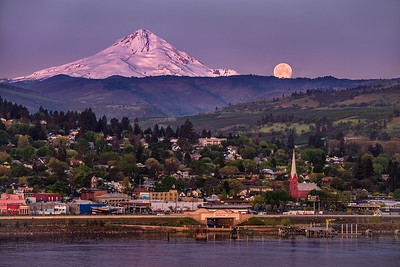 Sunrise illuminates Mt. Hood and the setting full moon over The Dalles