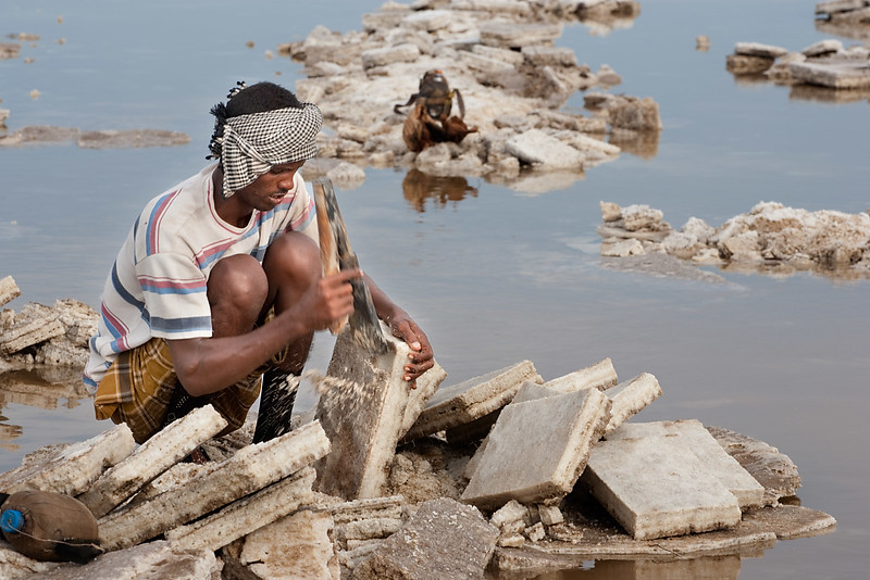The Afar people cuts the salt into manageable pieces.