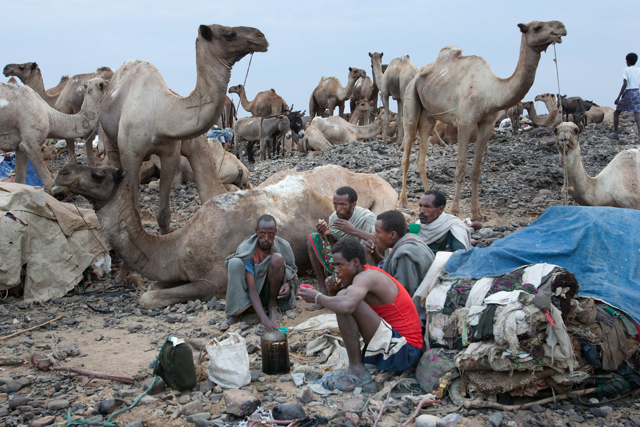 The camel drivers having an early breakfast in Hamed Ela before setting off to Lake Asale.