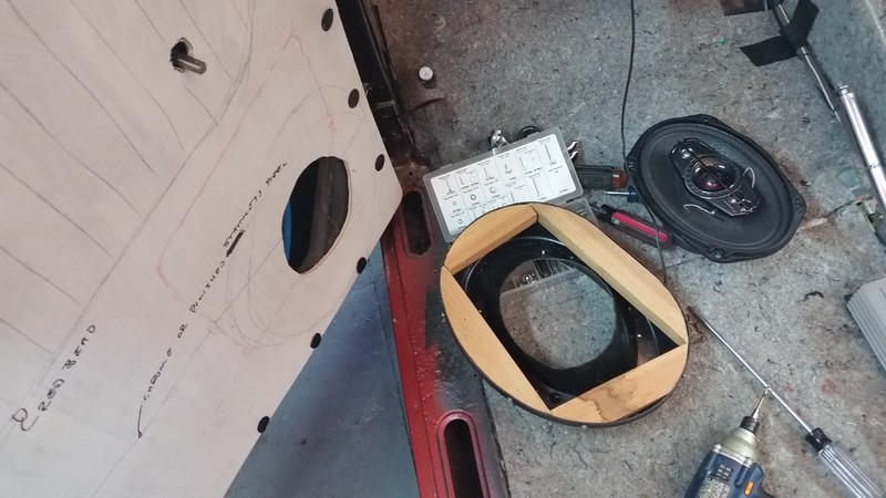 After some consideration I decided to revise the speaker concept and mount them in the doors rather than in the fiberglass enclosures I built on the kick panels.
