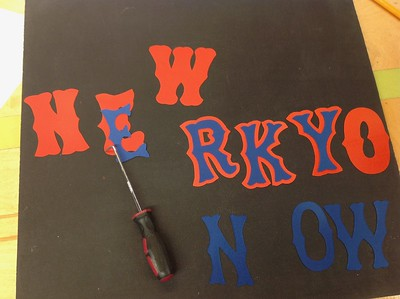 Using the computer-driven cutter, I cut the letters for this job one color at a time, align by hand and then heat press them together.