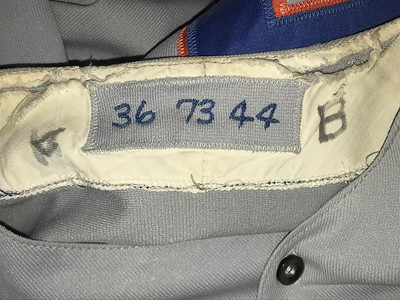 The neck tag tells the story: player number 36, 1973, size 44. The magic marker scrawl on either side must have had some later, minor league significance that is lost to me now.