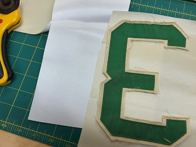 Now-- on to making the replacement lettering. Originally, when John F. Kennedy was President, the lettering was bright kelly green outlined with white. Years of use have dulled the material to a flat finish, and made the white fabric a beige color.   Normally, I start with white twill (far left) and dye it to match. But this jersey was so worn I actually decided to begin with beige twill (like is used on 2010 Diamondbacks uniforms), because it was a closer place to start. I'll still need to dye it a bit to match exactly.