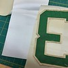 Now-- on to making the replacement lettering. Originally, when John F. Kennedy was President, the lettering was bright kelly green outlined with white. Years of use have dulled the material to a flat finish, and made the white fabric a beige color. <br /> <br /> Normally, I start with white twill (far left) and dye it to match. But this jersey was so worn I actually decided to begin with beige twill (like is used on 2010 Diamondbacks uniforms), because it was a closer place to start. I'll still need to dye it a bit to match exactly.