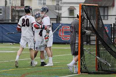 TIM JEAN/Staff photo  Central players from left, Shane McInnis (20) Deven DeBay (4) celebrate with Chase Dunn after he score a goal during a boys lacrosse game against Westford Academy. Central lost 11-10.  4/20/19
