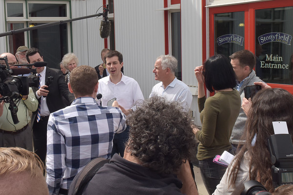 TIM JEAN/Staff photo  Democratic presidential candidate Pete Buttigieg, center, answers questions from the media standing next to Gary Hershburg, CEO of Stonyfield Yogurt during a campaign stop in Londonderry, NH.   4/19/19