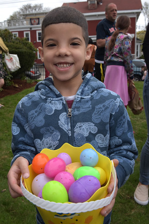 TIM JEAN/Staff photo  Liam Jimenez, 5, of Haverhill, is all smiles after gathering up a basket of plastic eggs during the Trinity Episcopal Church in Haverhill annual Easter Egg Hunt.  4/20/19